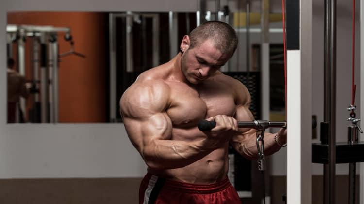 Bodybuilder performing cable curls