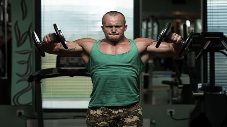 Man doing a dumbbell lateral riase