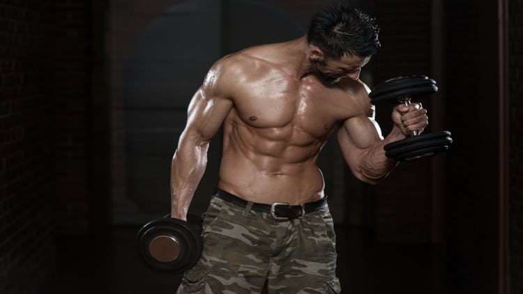 Man performing an alternating hammer curl