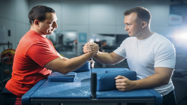 Two men in an arm wrestling contest