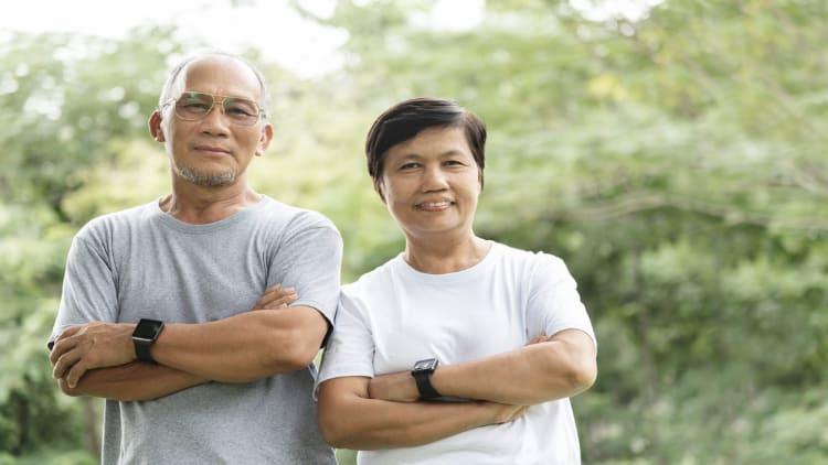 Senior Asian couple folding their arms
