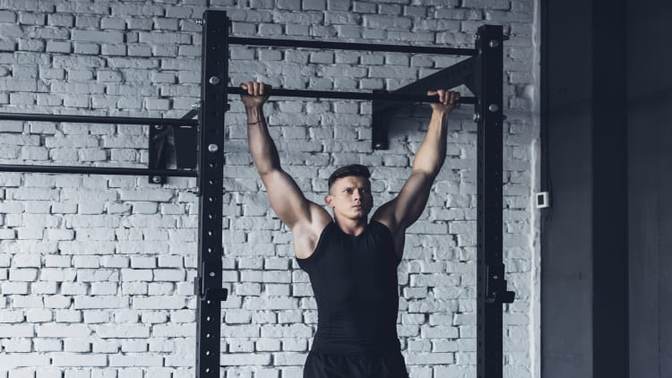 Athlete doing pull-ups