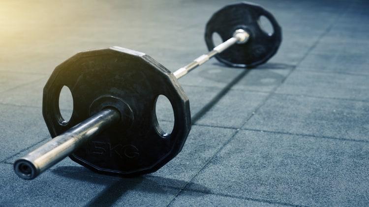 An Olympic barbell on the gym floor