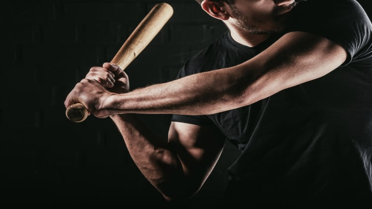 Man swinging a baseball bat