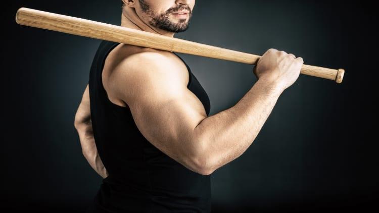 Muscular man holding a baseball bat