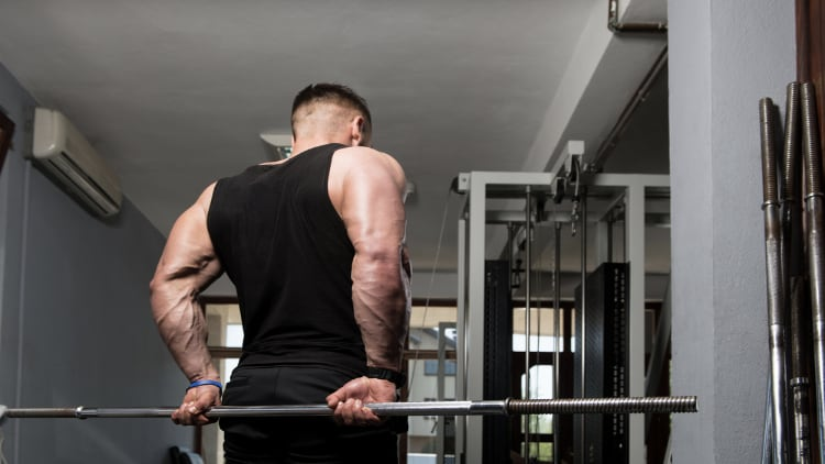 Man doing a behind the back forearm curl