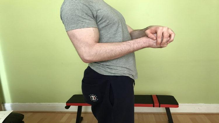 A man performing bodyweight hammer curls