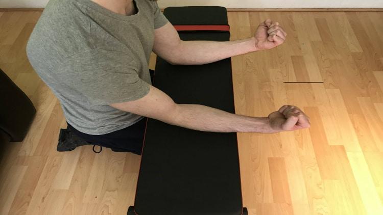 A man performing bodyweight wrist flexions