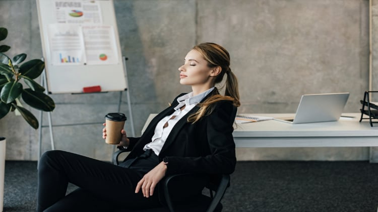 Businesswoman relaxing in a chair at work