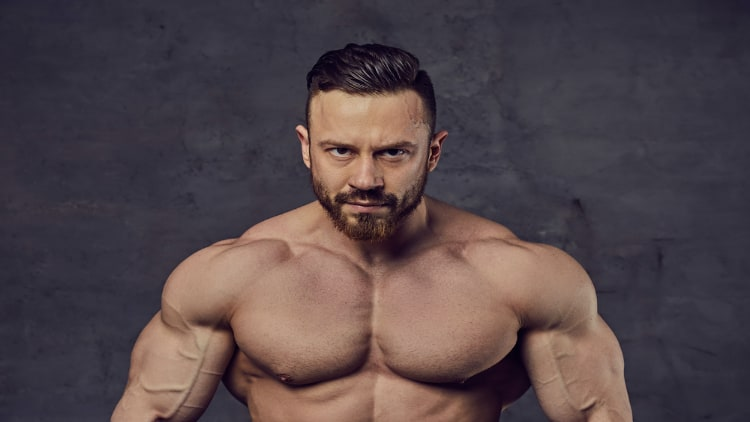 A confident bodybuilder looking at the camera