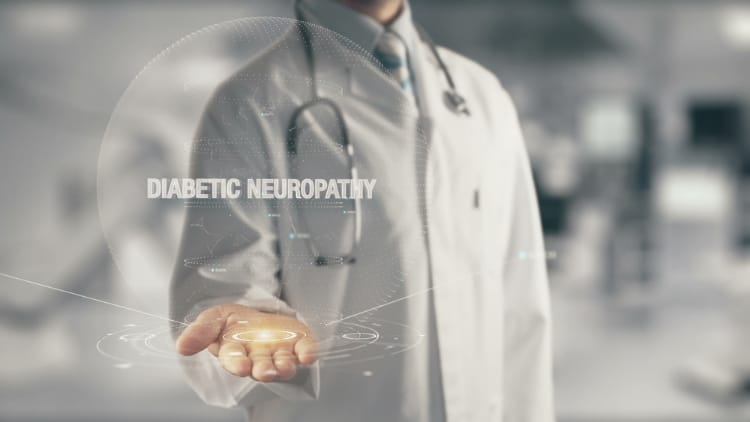 The word diabetic neuropathy overlayed over an image od a doctor