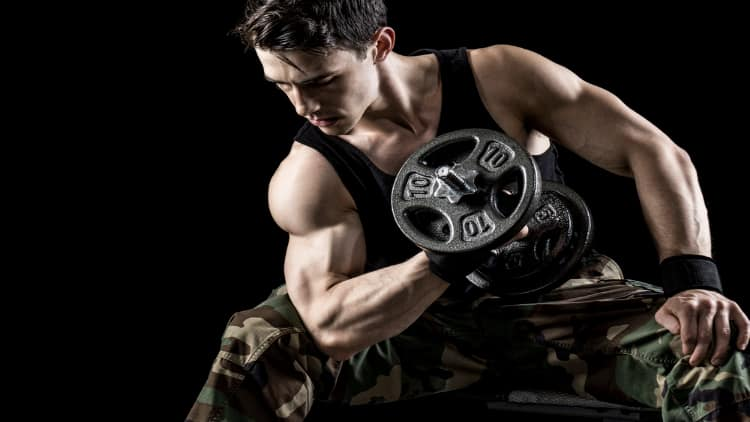 Man doing a dumbbell concentration curl