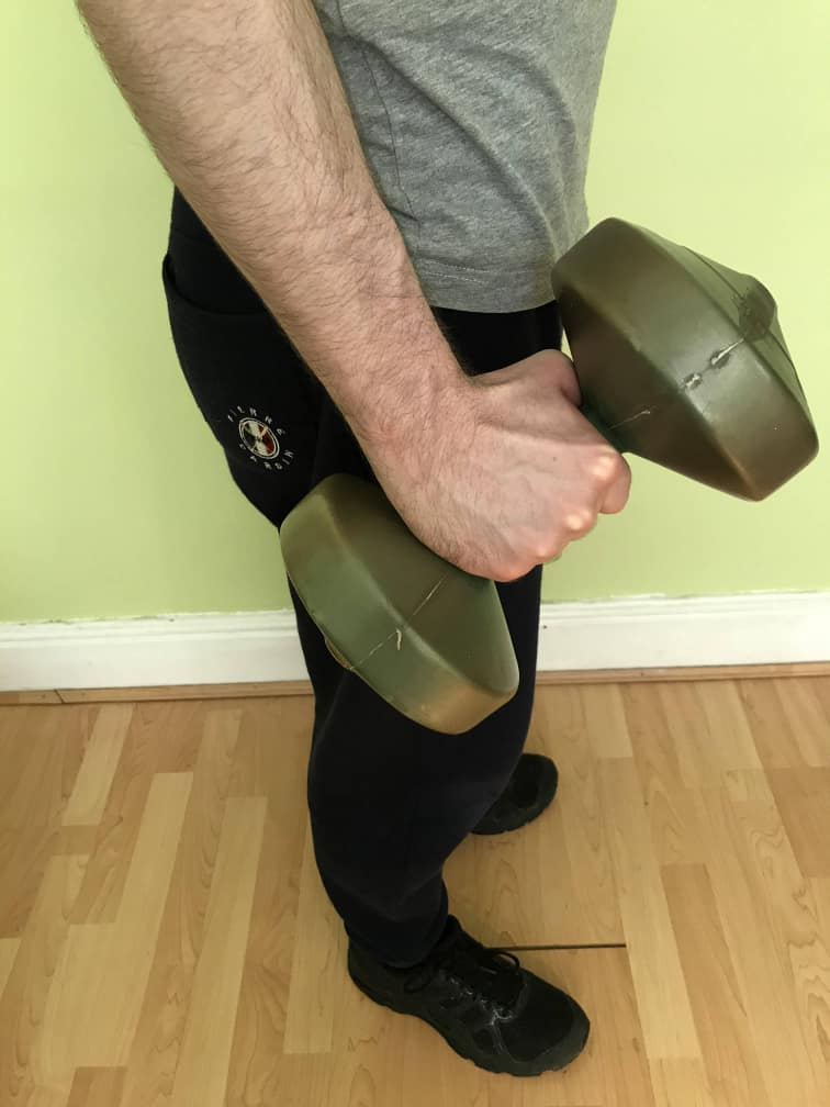 Person performing dumbbell radial deviations
