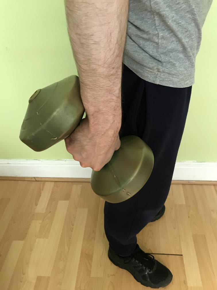 Person performing dumbbell ulna deviations