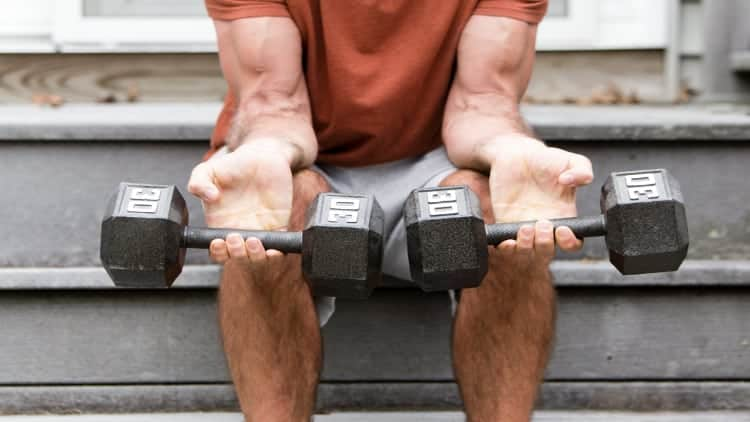 Man performing a dumbbell wrist curl