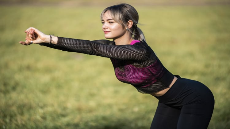 Fitness woman stretching outside