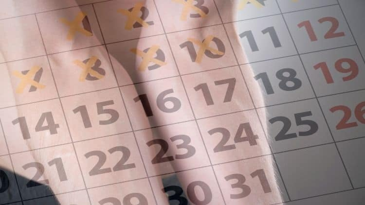 Image of a calander overloayed over a man's forearms