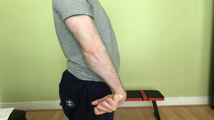 A man flexing his forearm muscles