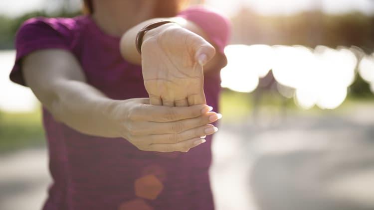 Woman stretching her forearm flexors