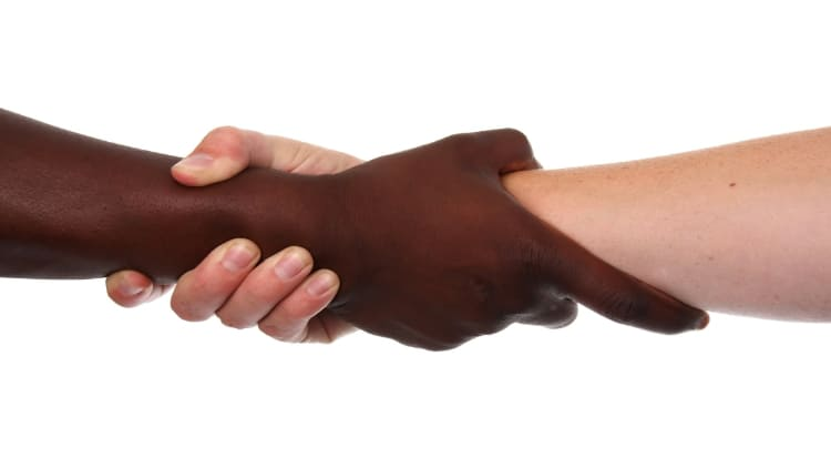 Two men performing the forearm handshake