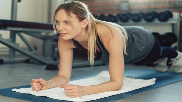 Lady performing the forearm plank exercise