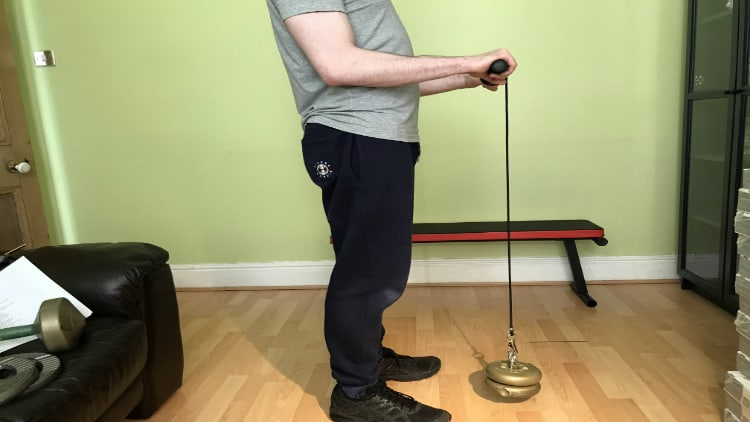 A man performing some forearm roller exercise