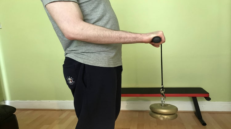 A man using a forearm roller