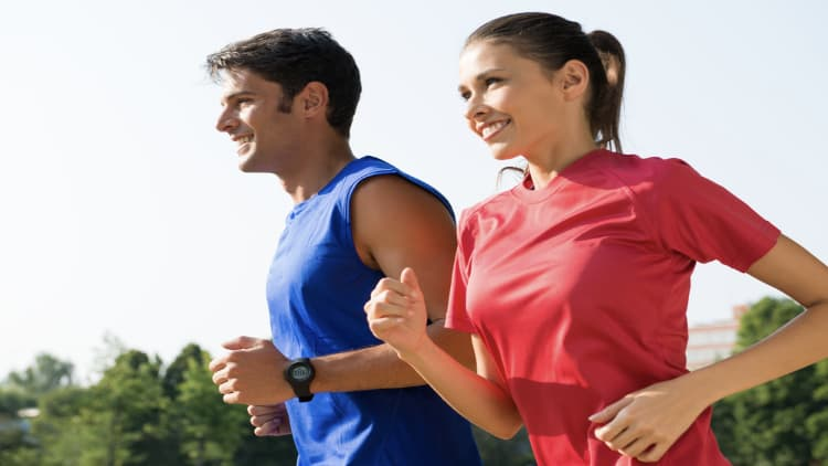 Happy couple jogging outside