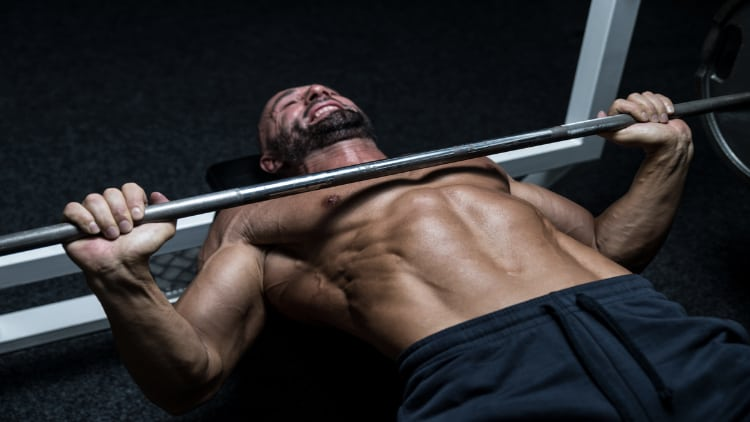 Man performing a heavy bench press