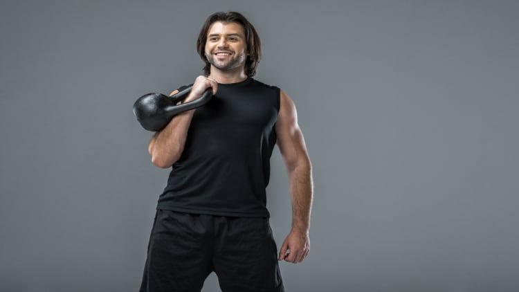 Man holding a kettlebell with an offset grip