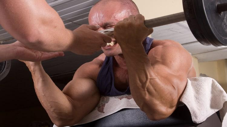 Man performing an intense preacher curl workout