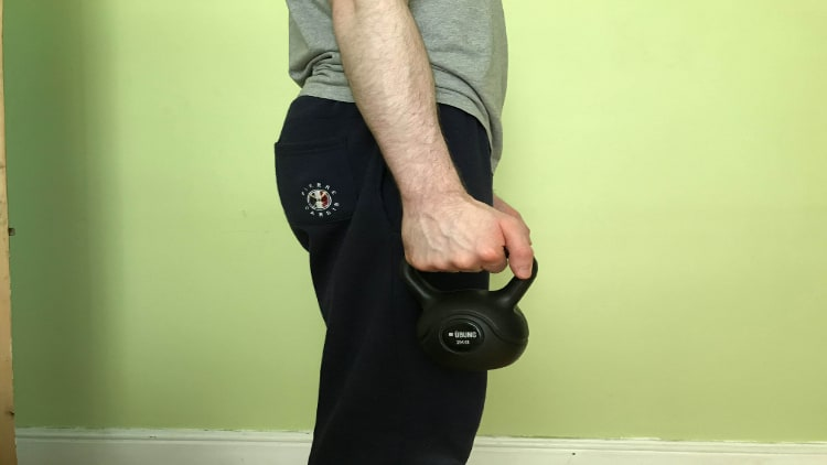The starting position of a kettlebell hammer curl