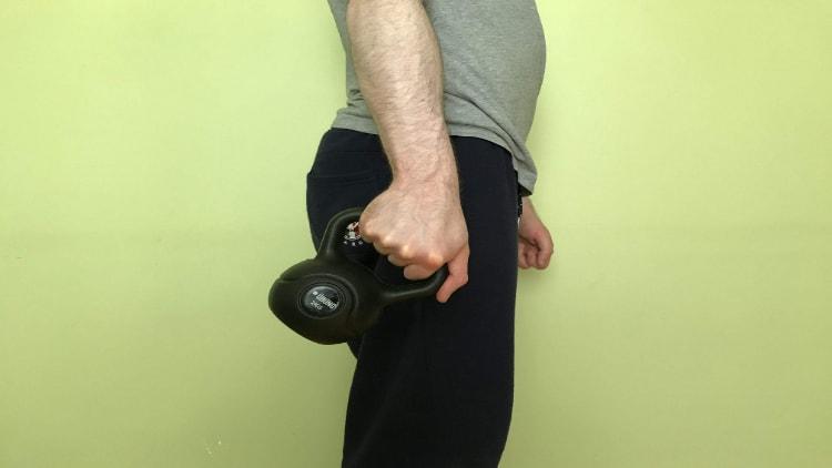 A man doing a kettlebell ulna deviation
