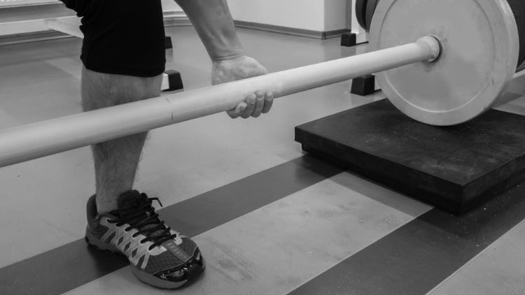 Man holding a thick barbell