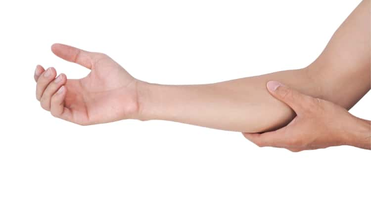 Man holding his forearm
