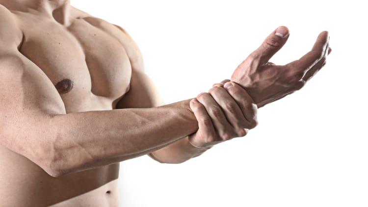 Man holding his wrist