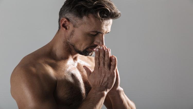 Shirtless man praying
