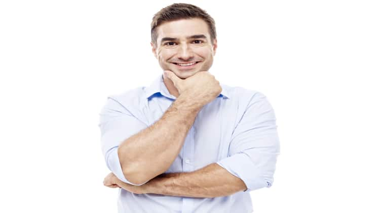 Man in a shirt with rolled up sleeves
