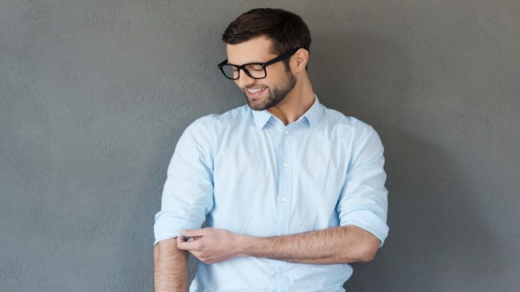 Man adjusting his sleeves