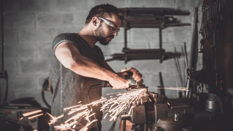 Man welding in garage