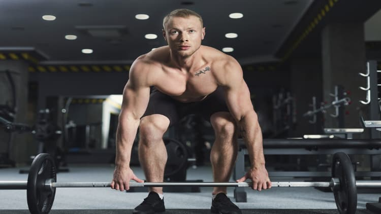 Man gripping the barbell during deadlifts