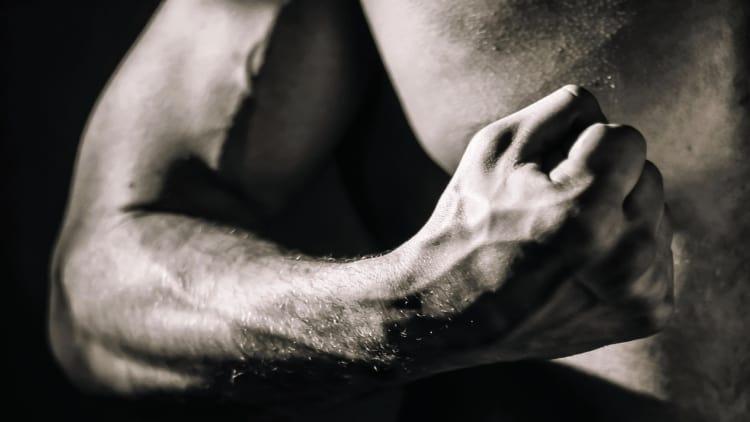 Man flexing his arm