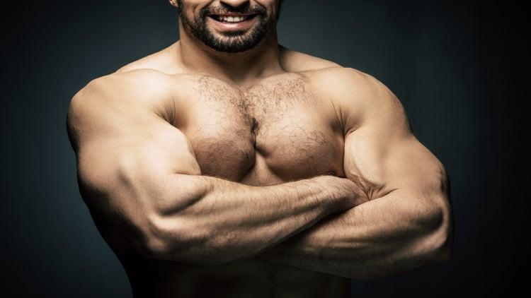 Muscular man folding his arms