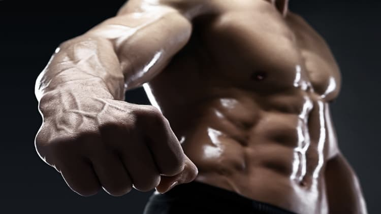 Fitness model showing his fist