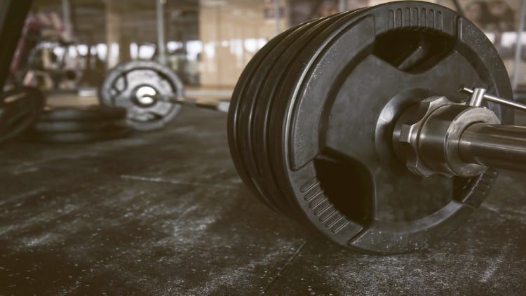 An Olympic barbell with weights on the gym floor