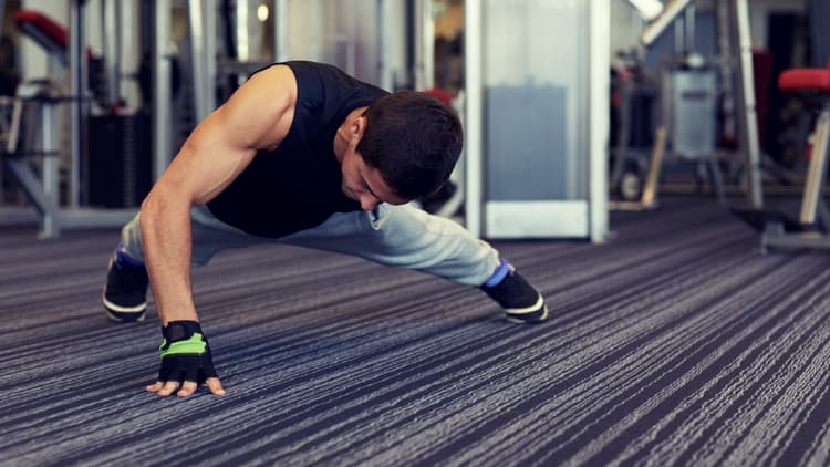 Man doing a one arm push up