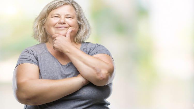 Overweight senior stroking her chin