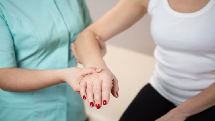 Physiotherapist assessing a client