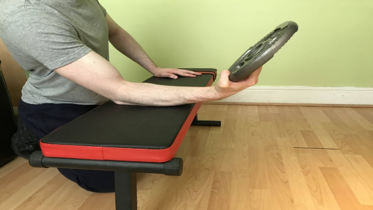 The end position of a plate wrist curl