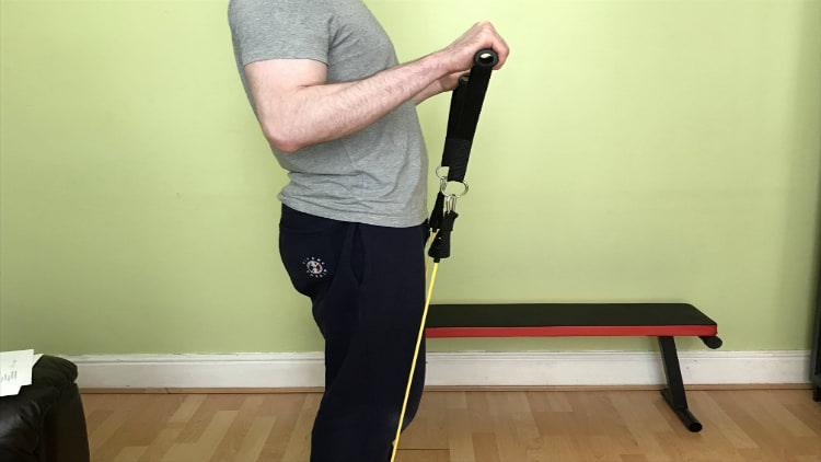Man doing a resistance band reverse curl